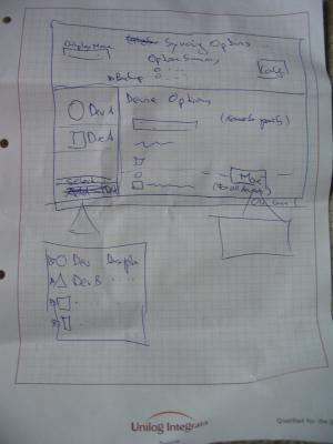Photo of a sheet of paper showing the first part of the KitchenSync design