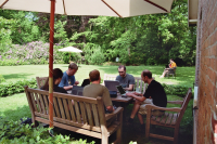 Photo of the group sitting in the garden and discussing the roadmap
