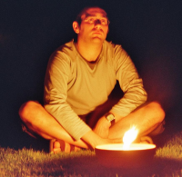 Photo of a developer sitting behind a candle in the garden discussing the roadmap